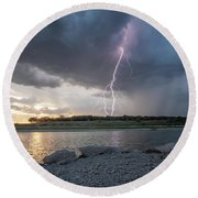 Large Lighting From Dark Clouds During Sunset At Large Lake Round Beach Towel