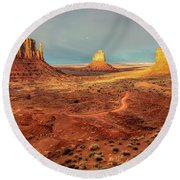 Last Light Over Monument Valley Round Beach Towel