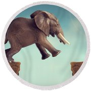 Leap Of Faith Concept Elephant Jumping Across A Crevasse Round Beach Towel