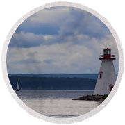 Lighthouse And A Sail Boat In Nova Scotia Round Beach Towel