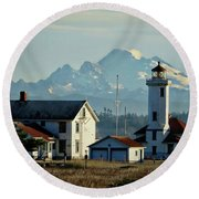 Lighthouse Before Mountain Round Beach Towel