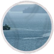 Lighthouse In The Bay Round Beach Towel