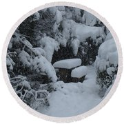 A Snowy Secret Garden Round Beach Towel