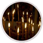 lit Candles in church  Round Beach Towel