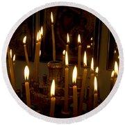 lit Candles in church  Round Beach Towel