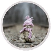 Little Teddy Bear Sitting In Knitted Scarf And Cap In The Winter Forest Between The Rails Round Beach Towel