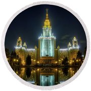 Lomonosov Moscow State University At Night Round Beach Towel by Alexey Kljatov