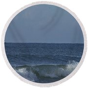 Lone Boat On The Horizon Round Beach Towel