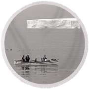 Lone Giant Iceberg And Small Sea Boat Round Beach Towel