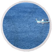 Lonely Fishing Boat Sailing On A Calm Blue Sea Round Beach Towel