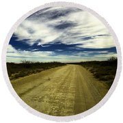 Long Dusty Road In Jal New Mexico  Round Beach Towel