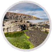 Low Tide At Cullernose Point Round Beach Towel