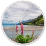 Lupin Flowers In Alpine Scenery At Kinloch, Nz. Round Beach Towel