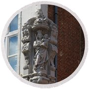Madonna And Child Statue On The Corner Of A House In Bruges Round Beach Towel