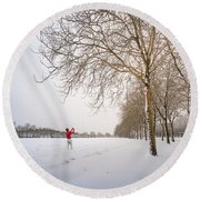 Man In Red Taking Picture Of Snowy Field And Trees Round Beach Towel