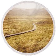 Man On Expedition Along Cradle Mountain Boardwalk Round Beach Towel