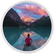 Man Sit On Rock Watching Lake Louise Morning Clouds With Reflect Round Beach Towel