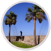 Man With A Hat On The Wall With Palm Trees In Saint Augustine Fl Round Beach Towel