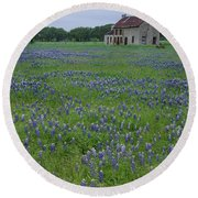 Marble Falls Texas Stone House And Bluebonnets Round Beach Towel