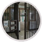 Metal Bars Leading Into Cellblock In Prison Round Beach Towel