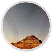 Moon Lit Castle Butte And Star Tracks In Scenic Saskatchewan Round Beach Towel