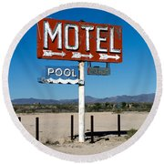 Motel Sign On I-40 And Old Route 66 Round Beach Towel