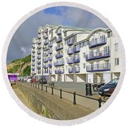 New Flats Overlooking Sandown Esplanade Round Beach Towel