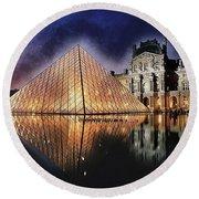 Night Glow Of The Louvre Museum In Paris Round Beach Towel