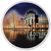 Night Glow Of The Louvre Museum In Paris  Text Louvre Round Beach Towel