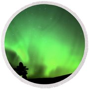 Northern Light Above An Inukchuk In Saskatchewan Round Beach Towel