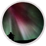 Northern Lights Above An Inukchuk In Saskatchewan Round Beach Towel