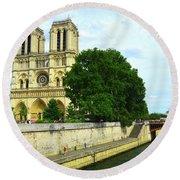 Notre Dame On The Seine Round Beach Towel
