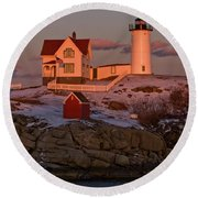 Nubble Light At Sunset Round Beach Towel by Paul Mangold