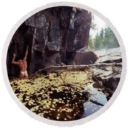 Nude Standing In A Leaf Pool  Round Beach Towel