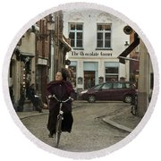 Nun On A Bicycle In Bruges Round Beach Towel