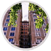 Nyc Building With Tree Overhang Round Beach Towel