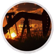 Oil Rig Pump Jack Silhouetted By Setting Sun Round Beach Towel