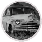 Old Chevy By The Levee Round Beach Towel