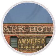 Old Faded Advertisement On An Old Brick Building Round Beach Towel