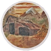 Old Farmhouse With Hay Stack In A Snow Capped Mountain Range With Tractor Tracks Gouged In The Soft  Round Beach Towel