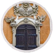 Old Ornate Door At The Cesky Krumlov Castle At Cesky Krumlov In The Czech Republic Round Beach Towel
