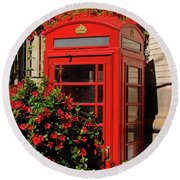 Old Red Telephone Box Or Booth Surrounded By Red Flowers In Toro Round Beach Towel
