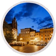 Old Town Square By Night In Torun Round Beach Towel