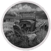 Old Truck Abandoned In The Grass In Black And White At The Ghost Town By Okaton South Dakota Round Beach Towel