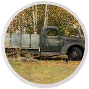 Old Truck With Potato Barrels Round Beach Towel