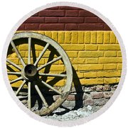 Old Wooden Wheel Against A Wall Round Beach Towel