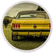 Old Yellow Mustang Rear View In Field Round Beach Towel