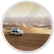One 4x4 Vehicle Off-roading In The Red Sand Dunes Of Dubai Emirates, United Arab Emirates Round Beach Towel