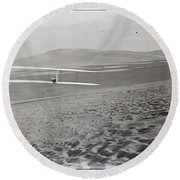 Orville Making Right Turn Showing Warping Of Wings Hill Visible In Front Of Him Kitty Hawk North Car Round Beach Towel