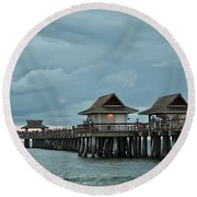 Clouds Over The Naples Pier Round Beach Towel